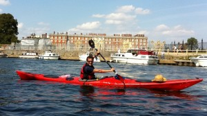Chelsea Kayak Club: Marlow to Cremorne Trip - Danny getting all excited about being on the water outside of Hampton Court Palace as he paddles by in the club's sea kayak during the two day trip along the Thames in July 2011 (www.chelseakayakclub.co.uk)